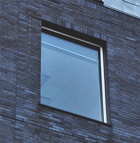Fönsterputsning - Bild på en fönsterbåge