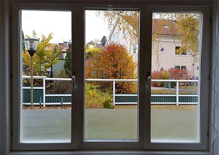 Fönsterputsning - Bild på tre fönsterbågar